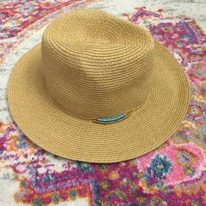 Straw wide-brim hat + beaded accent